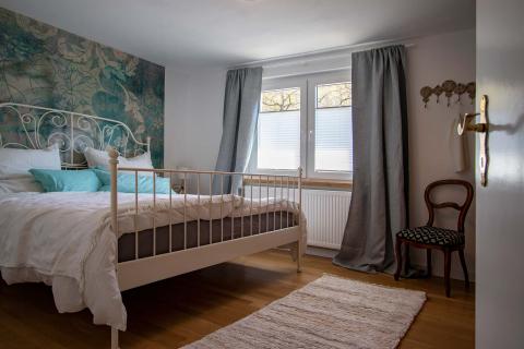 Schlafzimmer in der Ferienwohnung Bauland